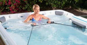 a woman rowing, one of the 4 ways to meet your fitness goals with Endless Pools