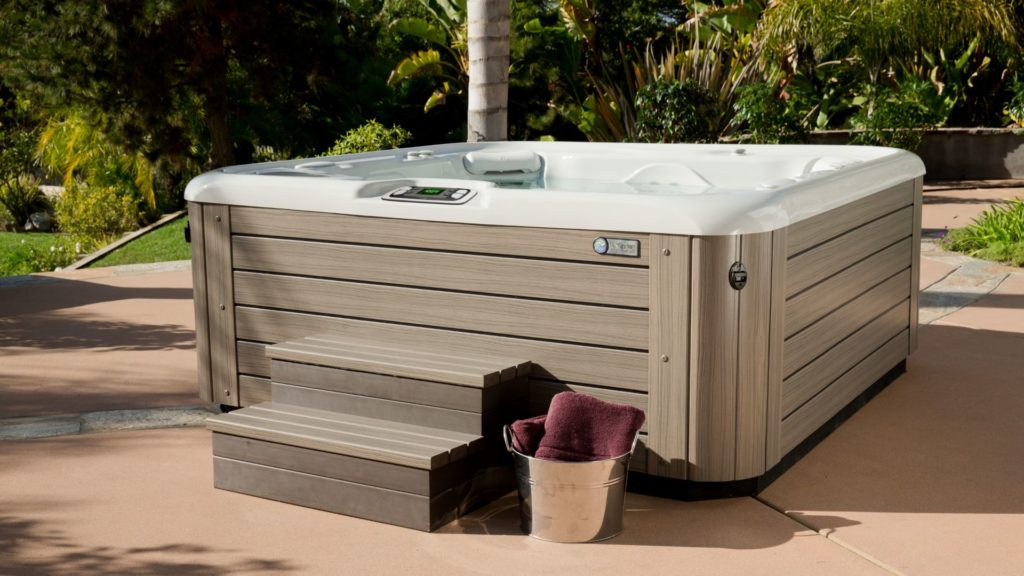 a hot tub being cared for with hot tub water care 101
