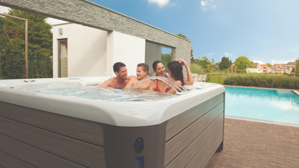 a family enjoying one of these 3 ways to spend quality family time in a hot tub